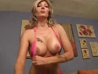 Wealthy platinum-blonde chick in pinkish bathing suit is throating her neighbor's manmeat, in her living apartment