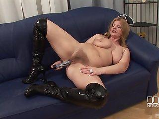 Mature MILF model takes of her costume and masturbates