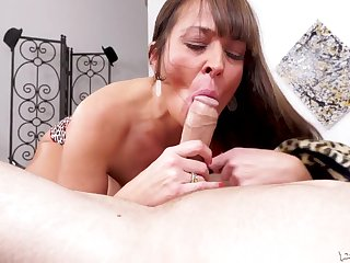 Milf cocksucker between his legs working his stiff dick