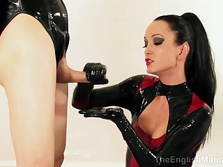 Latex Domina strokes thick dick and makes throbbing wiener cum