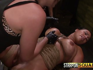 Two kinky mistresses fuck pussy of one busty tied up lesbian hooker