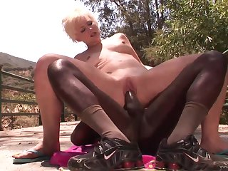 Hot mommy Nora Skyy rides her first mammoth black cock