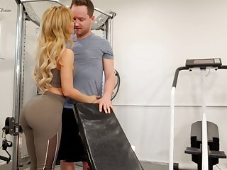 Mouth watering seductress Cherie Deville hooks up with her fitness instructor