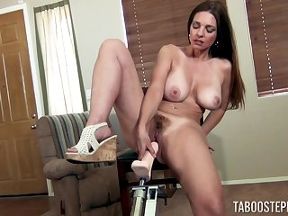 Mindi Mink masturbates badly on the chair using her long sex machine