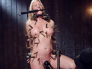 Nude busty mature hurt and dominated in full clamping BDSM