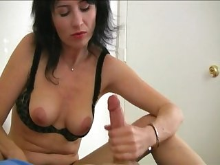 Mature brunette pleasures her pussy and strokes her lover's dick