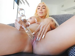 Aroused blonde pushes the glass toy as deep as possible