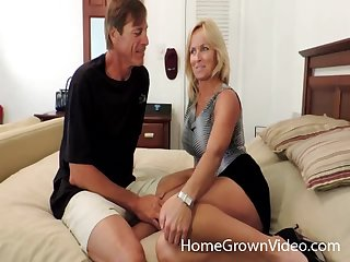 Blonde wife enjoys playing with her husban'd dick and her toy