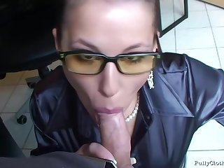 Office lady with glasses is sucking her colleague's dick when she does not have any work to do