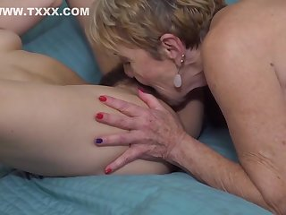 Brunette with hairy pussy is making love with a blonde lesbian and enjoying it a lot