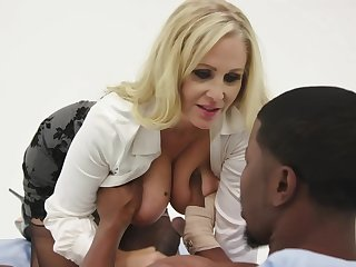 Julia Ann is having steamy sex with a black man, instead of doing her job