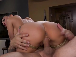 Busty babe is tied up and impaled on that man's big pecker