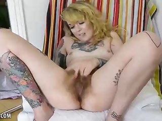 Inked honey took off her lacy undies and commenced playing her furry fuckbox, just for joy