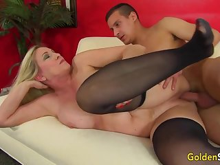 Towheaded mature bi-atch in dark-hued pantyhose, Cala Thirsts is penetrating a junior lad like a superslut