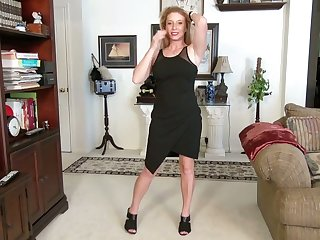 Middle aged blonde Jasper Shelton is toying her muff doggy style
