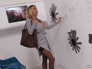 Plastic blonde bimbo Danielle Derek fucks a big black glory hole cock