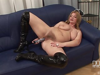Mature MILF model takes of her costume and masturbates